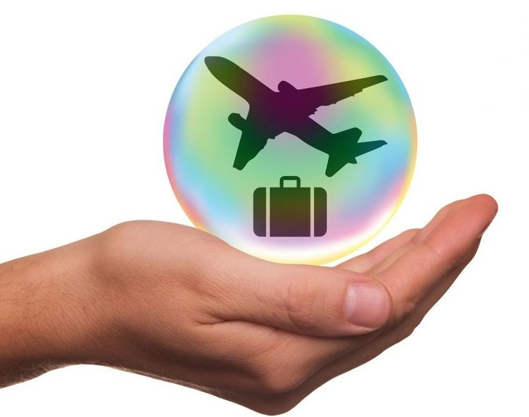 travel resources - hand with luggage and airplane icon in it